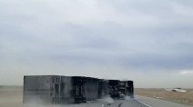 Dangerous winds take down a transport truck on a major Canadian highway