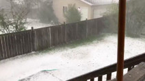 Hail blankets lawns in southern Alberta as storms track through