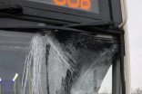 Ice flies off transport truck on 401, shatters GO bus window