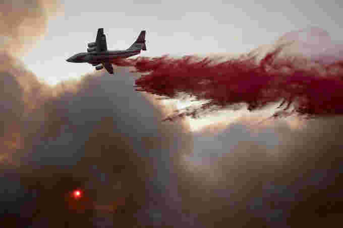 Reuters wildfire water bomber