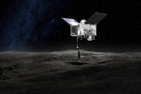NASA's OSIRIS-REx probe successfully tags giant 'rubble pile' asteroid Bennu