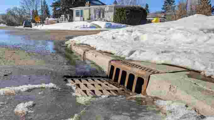 The City of Regina asks residents to be mindful of traffic and COVID-19 restrictions when clearing their adopted storm drains. (Ashleigh Mattern/CBC)