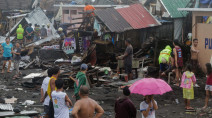 Typhoon kills three in Philippines, hundreds of flights halted
