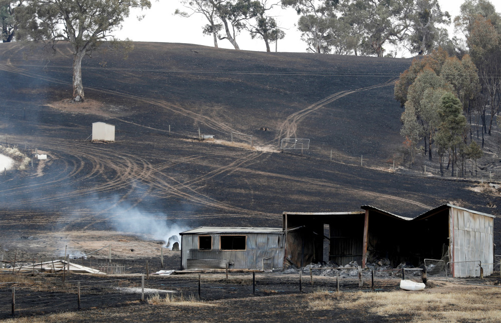 Australian firefighters access badly burned towns