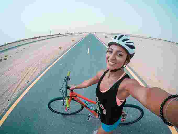 Bike rider takes selfie in the middle of the road