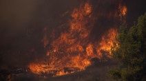 Battle to contain Southern California canyon blaze aided by easing winds