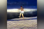 Man goes for a swim in the coldest village on Earth