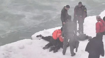 Man rescued after falling through icy waters of Lake Michigan