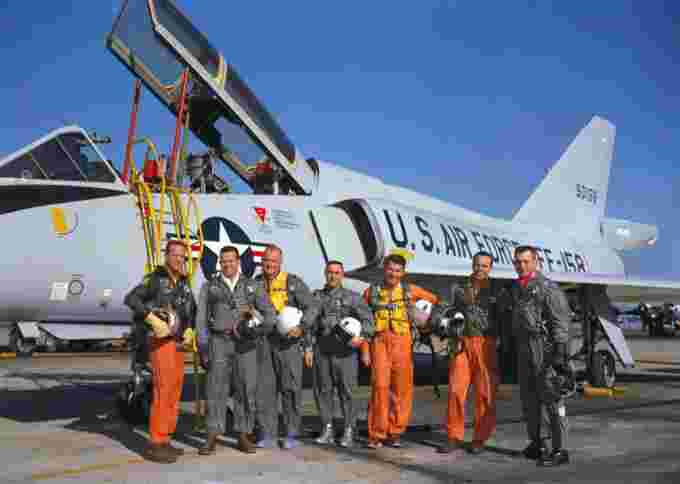 The Mercury Seven in front of an F-106 Delta Dart
