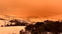 Eerie dust storm turns sky orange over snowy mountains in Australia