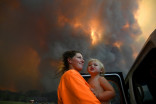 Australians ordered to flee flames as fires rage in east and west
