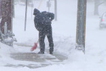 Avoid injury when shovelling snow by doing this