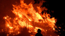 Deadly L.A. wildfire burns with subdued fury after change in weather