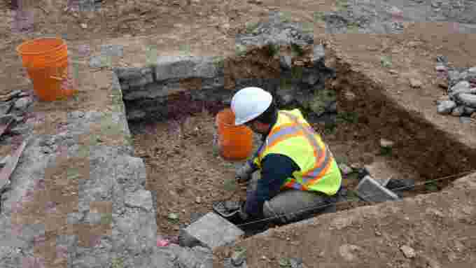 worker-digging-excavation-site-east-of-centre-block