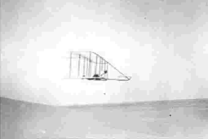 Wilbur Wright flies a glider in earlier tests Kitty Hawk, Oct. 10, 1902.