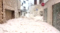 Sea foam floods streets in Spanish town after Storm Gloria
