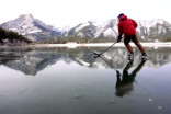 VIDEO: Skaters glide on crystal-clear frozen mountain lakes