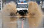 Rescuers search floodwaters for missing people in typhoon-hit Japan