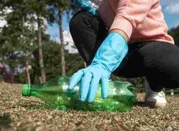 Getty Images: Picking up litter, garbage, recycle helps earth on Earth Day