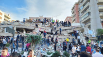Large buildings collapse as powerful quake rocks Turkey, Greece