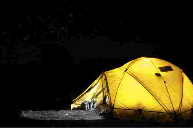 PEXELS: Camping under starry sky. Courtesy: Pixabay. URL: https://www.pexels.com/photo/yellow-tent-under-starry-night-45241/