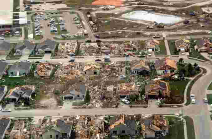 Aerial view of damage to homes in Lakeside subdivision in Kissimmee, Florida. The tornado moved from the upper right to the lower left, narrowly missing a school. Photograph courtesy of Robert Sheets