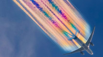 Photographer captures airplane with a technicolour trail
