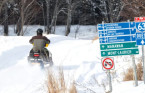 Quebec tightens rules on adventure tourism as search for snowmobilers resumes