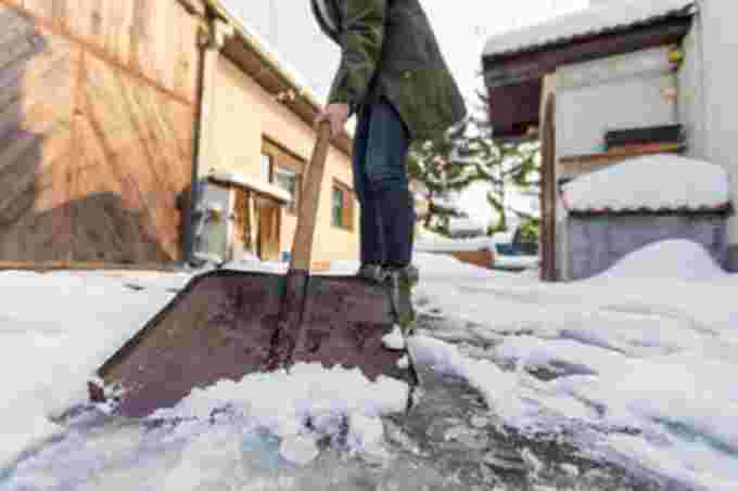 getty woman shoveling snow
