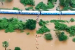 More than 1,000 people rescued from flood-stranded train in India