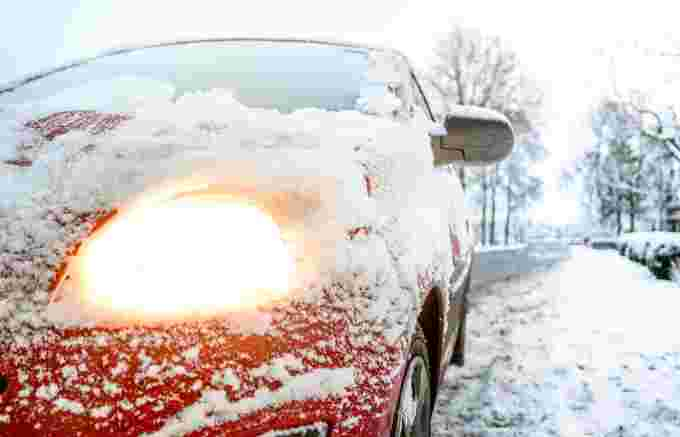 snow-covered-red-sedan-730901