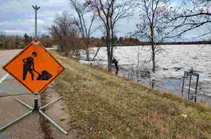 crews-pumping-along-river-road-to-manage-high-water