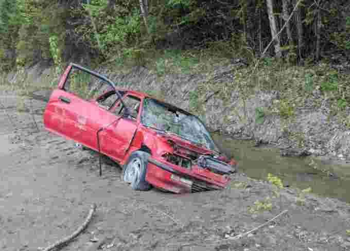 CBC File Photo: A car stuck in the mud along West Fraser Road in Quesnel after washouts and slides in 2018. (Steve Anderson/Contributed )