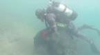 Divers navigate WWII mines to clean one of Europe's most polluted coastlines