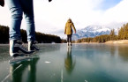 Multiple skaters fall through ice in Banff