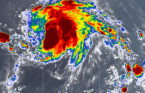 Jerry strengthens to a hurricane, forecast to pass north of Leeward Islands