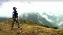 Handful of golfers tee off in Mount Everest tournament in bad weather