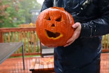 There's a trick to carving a pumpkin in the rain
