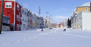 Potent lows powering through Atlantic Canada with hefty snow, winds