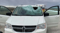 Driver knocked unconscious after ice chunk flies off truck, breaking windshield